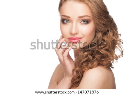 Portrait of attractive young woman with stylish bright makeup and curly hairstyle. Isolated on white background