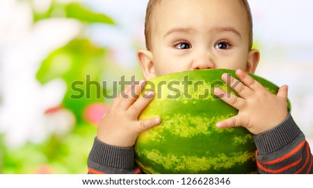 Portrait Of Baby Boy Eating Watermelon, outdoor - stock photo