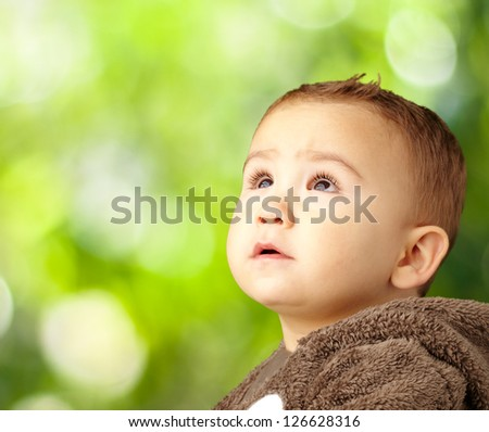 Portrait Of Baby Boy Wearing Warm Clothing against a nature background - stock photo