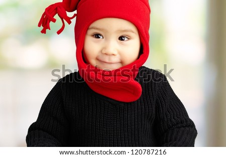 Portrait Of Baby Boy Wearing Warm Clothing at his home, indoor - stock photo
