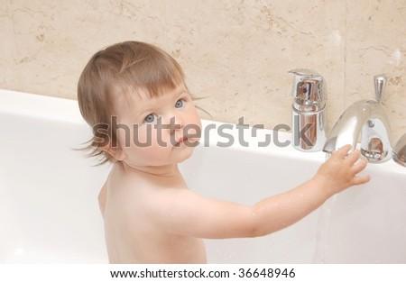 Portrait of baby in bath - stock photo
