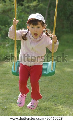 Portrait of baby on the swing