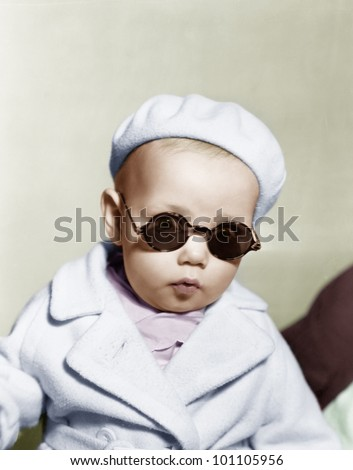 Portrait of baby wearing beret and sunglasses - stock photo