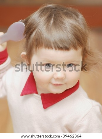Portrait of baby with hair comb - stock photo