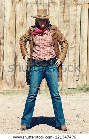 Portrait of bad cowgirl. Western movie style - stock photo
