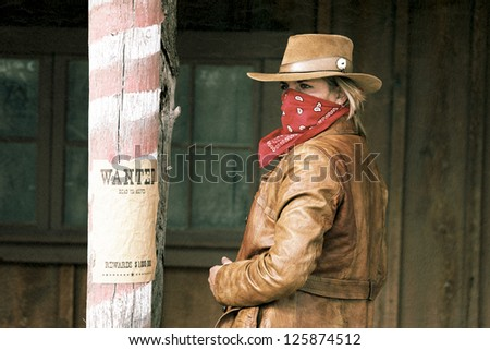 Portrait of bad wanted girl. Western movie style - stock photo
