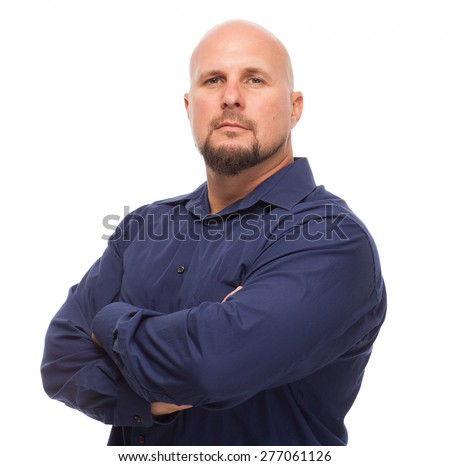 Portrait of bald, handsome young man isolated on white background. Caucasian man with beard looking serious with arms crossed and looking forward. - stock photo