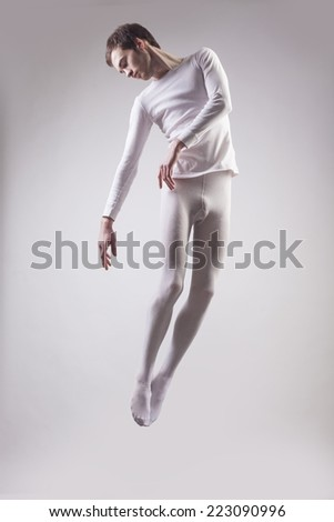 Portrait of ballet dancer who is dancing in white clothes. Isolated in white background