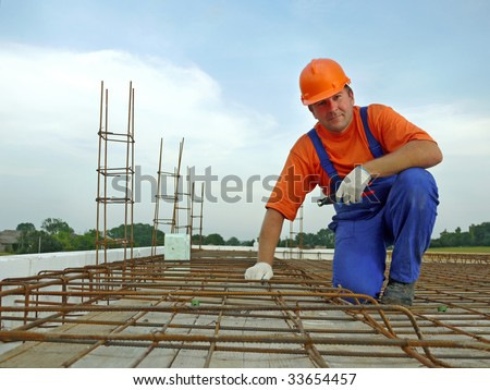Portrait of bar bender on slab steel reinforcement