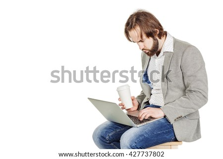 portrait of bearded business man working on his laptop. emotions, facial expressions, feelings, body language, signs. image on a white studio background.