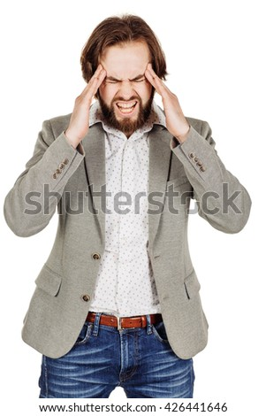 portrait of bearded businessman standing with headache.  human emotion expression and office, business, technology, finances and internet concept. - stock photo