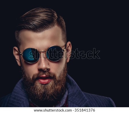 Portrait of bearded man in sunglasses. Isolated on black background. - stock photo