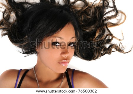 Portrait of beautiful African American woman laying over white background