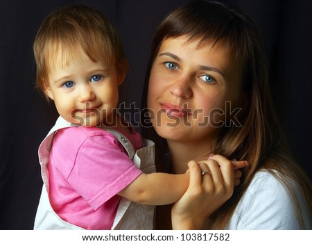 portrait of beautiful and happy mom and baby - stock photo