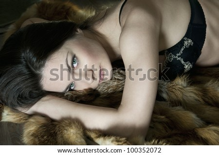 Portrait of beautiful and sexy young woman in underwear laying down on floor - stock photo