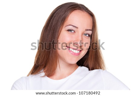 portrait of beautiful and smiley caucasian woman with long hair over dark background - stock photo