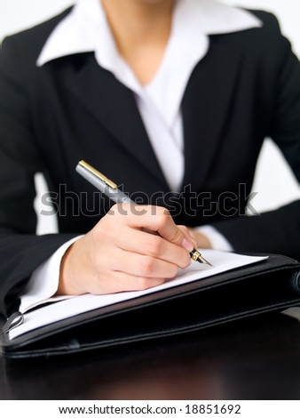 Portrait of beautiful and young business woman working at the desk