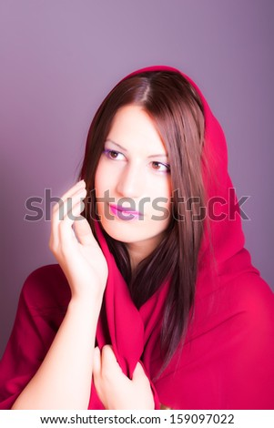 portrait of beautiful arabic woman wearing red scarf - stock photo