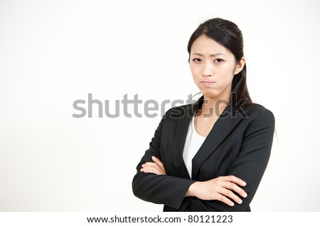 portrait of beautiful asian businesswoman getting angry - stock photo