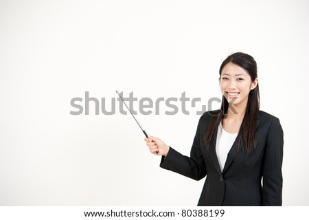 portrait of beautiful asian businesswoman pointing - stock photo