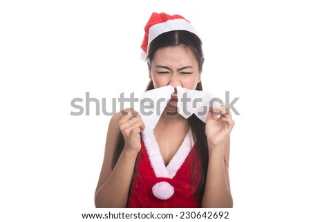 Portrait of beautiful Asian girl(Asian woman) wearing Santa Claus clothes,Santa girl,Christmas girl,x-mas,Sick woman with fever sneezing in tissue,the common cold,Flu,isolated on white background - stock photo