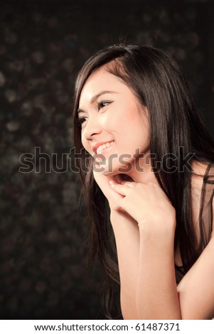 portrait of beautiful asian girl on black background - stock photo