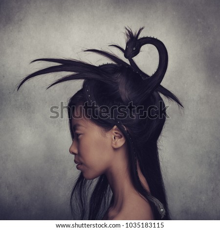 Portrait of beautiful asian girl with creative dragon hairstyle