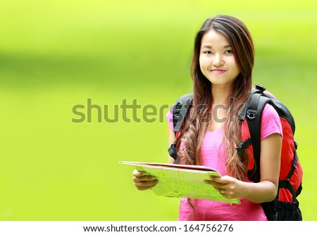 portrait of beautiful asian student wearing backpack smiling to camera - stock photo