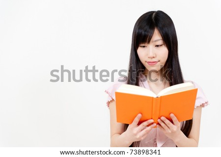 portrait of beautiful asian woman reading a book