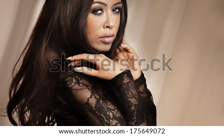 Portrait of beautiful attractive brunette woman looking at camera. - stock photo