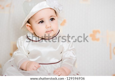 Portrait of beautiful  baby girl in dress and hat - stock photo