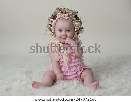 Portrait of Beautiful Baby Girl Wearing A Hat - stock photo