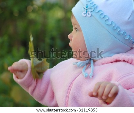 Portrait of beautiful baby in park - stock photo
