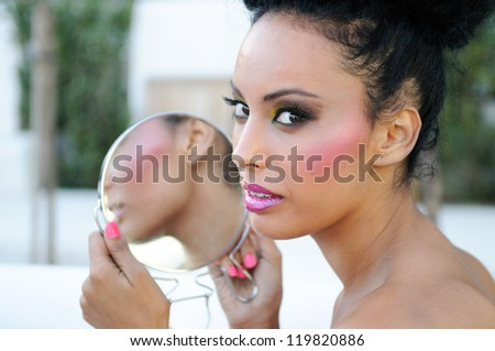 Portrait of beautiful black girl with mirror - stock photo