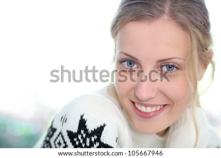 Portrait of beautiful blond girl on white background - stock photo