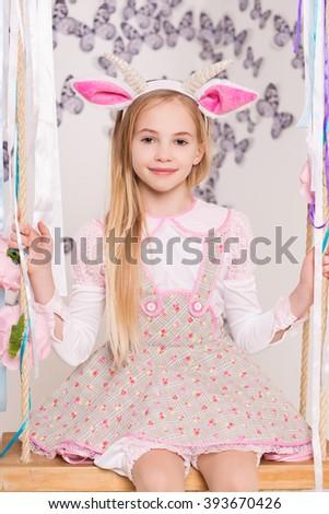 Portrait of beautiful blond girl wearing goat costume - stock photo