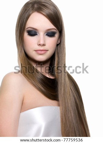 Portrait of beautiful blond girl with bright eye make-up and beautiful long straight hair - stock photo