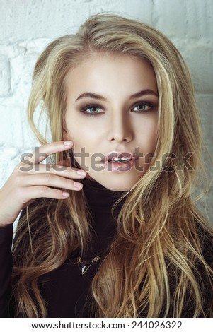 Portrait Of Beautiful Blond Woman. Curly Long Hair. Glamour vogue style portrait