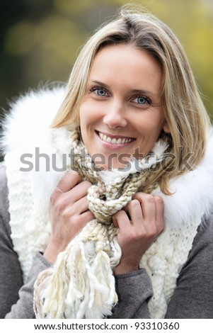 portrait of beautiful blond woman in cold in autumn - stock photo