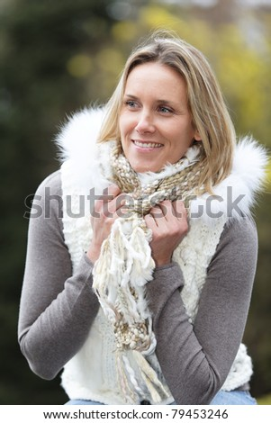 portrait of beautiful blond woman outdoor in autumn - stock photo