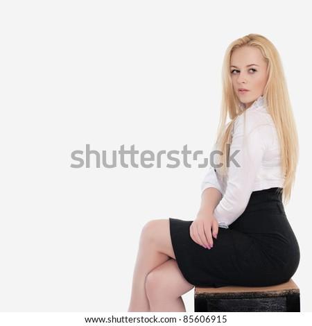 portrait of beautiful blond woman posing on white - stock photo