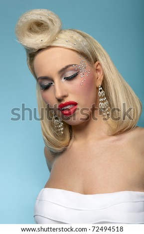 Portrait of beautiful blond woman with fashion make up and hairstyle, eyes closed - stock photo