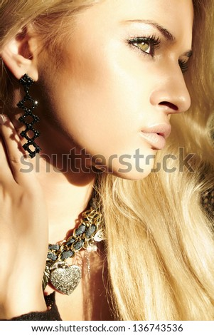 portrait of beautiful blond woman with shade from the sun. daylight - stock photo