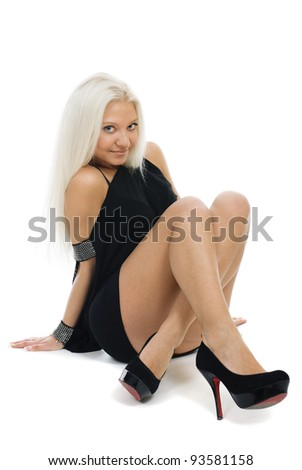 Portrait of beautiful blond young woman in black dress isolated over white background