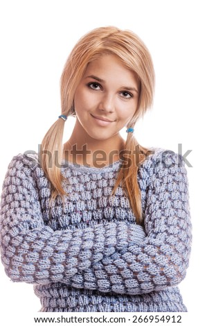portrait of beautiful blonde girl in blue pullover on white - stock photo