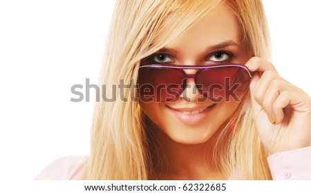 portrait of beautiful blonde girl looking over her sunglasses - stock photo