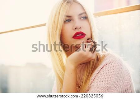 Portrait of beautiful blonde lady at sunset - stock photo