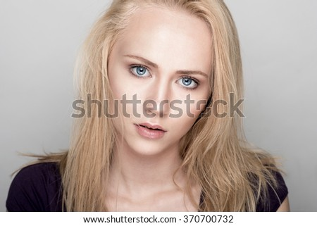 Portrait of beautiful blonde teenager