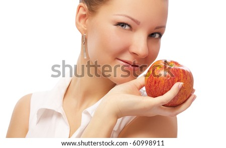 portrait of beautiful blonde with red apple on white