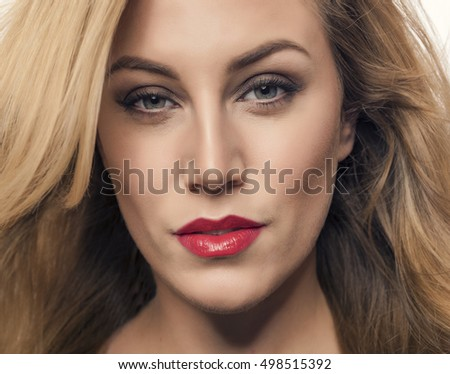 Portrait of beautiful blonde with red lips.